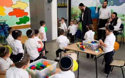 Ultra orthodox Jewish boys, pupils at the Poalei Menahem Talmud Torah, in the Beitar Illit settlement on September 4, 2016. (Nati Shohat/Flash90)