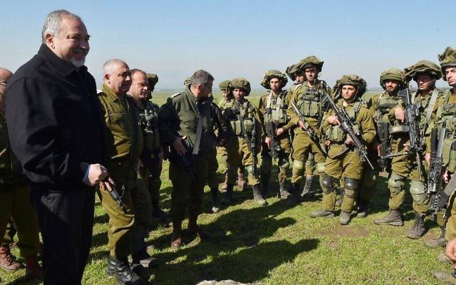 Defense Minister Avigdor Liberman and IDF Chief of Staff Gadi Eisenkot visit an IDF drill in the Golan Heights on February 21, 2017. (Ariel Hermoni/Defense Ministry/Flash90)