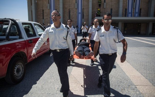 Illustrative image of emergency services and first responders participating in an emergency drill simulating an earthquake at the Knesset, in Jerusalem, June 13, 2017. (Hadas Parush/Flash90)