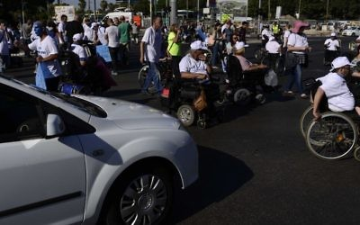 Illustrative: Disabled activists attend a protest calling for better health care in Tel Aviv on June 13, 2017. (Tomer Neuberg/Flash90)