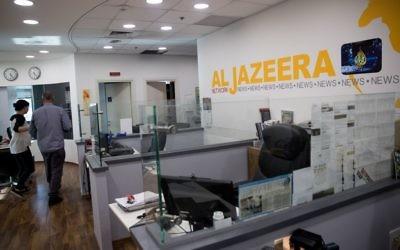Workers at the al-Jazeera offices in Jerusalem on June 13, 2017. (Yonatan Sindel/Flash90)