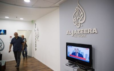 Workers at the al-Jazeera offices in Jerusalem on June 13, 2017. (Yonatan Sindel/Flash90)