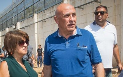 Former Arab Israeli MK Basel Ghattas enters Gilboa Prison to serve his 2-year sentence on July 2, 2017. (Basel Awidat/Flash90)