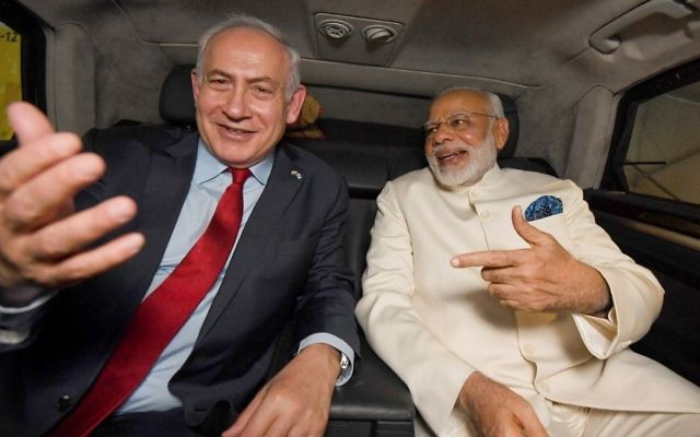 Prime Minister Benjamin Netanyahu sits in a car with his Indian counterpart Narendra Modi after the latter arrived at Ben Gurion International Airport in Tel Aviv on July 4, 2017. (Haim Zach/GPO/Flash90)