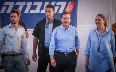 Labor party leader Isaac Herzog arrives with his wife Michal to casts his vote at a polling station in Tel Aviv on July 4, 2017.(Miriam Alster/Flash90)