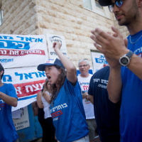 Labor party activists shout slogans outside a primary polling station in Jerusalem on July 4, 2017. (Yonatan Sindel/Flash90)