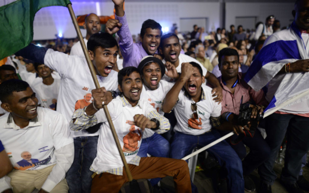 Members of the Indian community in Israel celebrate during an event marking 25 years of good relations between Israel and India during the official visit of the Indian Prime Minister Narendra Modi, at the Convention Center in Tel Aviv, on July 5, 2017. (Tomer Neuberg/Flash90)