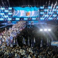 Jewish athletes participating in the 20th Maccabiah Games, wave their national flag during the opening ceremony of the Maccabiah Games in Jerusalem, July 6, 2017. (Yonatan Sindel/Flash90)
