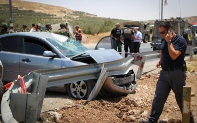 The scene of a car-ramming attack on a highway in the central West Bank on July 10, 2017 (Gershon Elinson/Flash90)