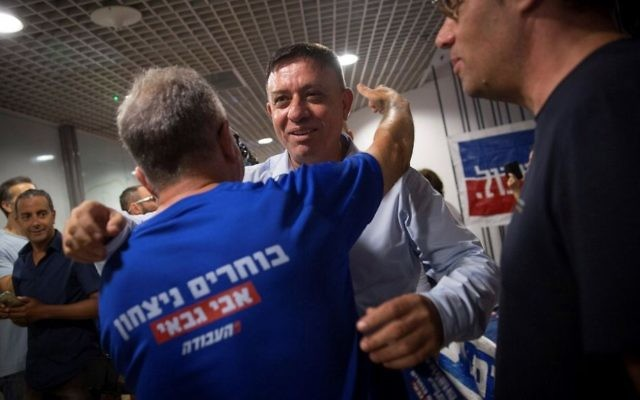 Avi Gabbay arrives to a polling station in Tel Aviv on July 10, 2017. (Miriam Alster/Flash90)