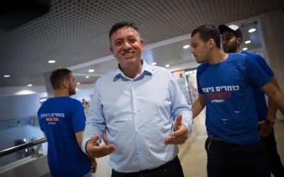 Labor party candidate Avi Gabbay arrives to a polling station at Dizengoff Center in Tel Aviv on July 10, 2017. (Alster/Flash90)