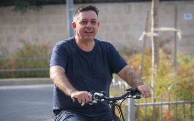 Newly elected head of the Labor party, Avi Gabbay, seen riding his bicycle outside his home on July 11, 2017. (Flash90)