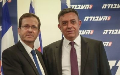 Newly elected head of the Israeli Labor party Avi Gabbay (R) with former leader Isaac Herzog on July 12, 2017. (FLASH90)