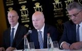 US President Donald Trump's Middle East envoy Jason Greenblatt (C) sits next to Israel's Regional Cooperation Minister Tzachi Hanegbi (L) and Mazen Ghoneim (R), head of the Palestinian Water Authority,  during a news conference about a water-sharing agreement between Jordan, Israel and the Palestinian Authority, in Jerusalem, July 13, 2017. (Yonatan Sindel/Flash90)
