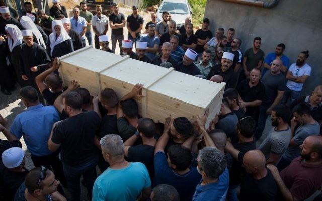 Family and friends carry the coffin of Israeli Druze police officer Haiel Sitawe, 30, during his funeral in the northern village of Maghar, July 14, 2017. Haiel Sitawe and Kamil Shnaan where killed early on Friday in a shooting attack near the Temple Mount complex in the Old City of Jerusalem. (Basel Awidat/Flash90)