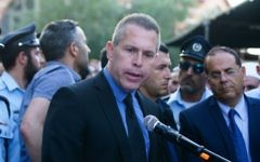 Public Security Minister Gilad Erdan speaks at the funeral of Israeli Druze police officer Kamil Shnaan in the northern village of Hurfeish, July 14, 2017. (Basel Awidat/Flash90)