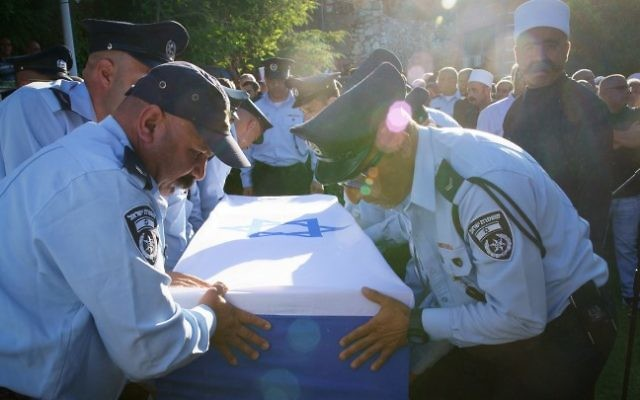 Israeli police members carry the coffin of Israeli Druze police officer Kamil Shnaan during his funeral in the northern village of Hurfeish, July 14, 2017. Haiel Sitawe and Kamil Shnaan where killed early on Friday in a shooting attack near the Temple Mount complex in the Old City of Jerusalem. (Basel Awidat/Flash90)