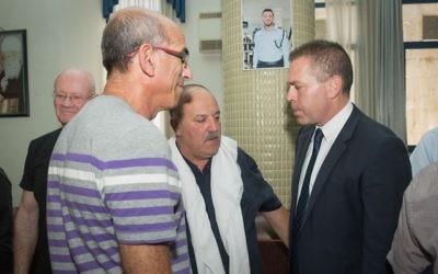 Public Security Minister Gilad Erdan visits the family of Israeli Druze police officer Kamil Shnaan in the northern village of Hurfeish, July 16, 2017. (Awidat/Flash90)