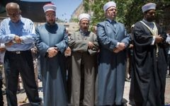 File: Waqf officials and others prepare to pray outside the Temple Mount, in Jerusalem's Old City, rather than enter the compound via metal detectors set up by Israel following a terror attack, July 16, 2017. (Yonatan Sindel/Flash90)