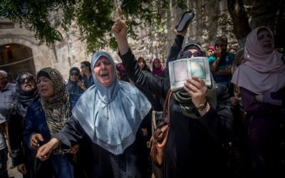 Muslim women protest in front of the Lion's Gate entrance to the Temple Mount, in Jerusalem's Old City, after metal detectors were placed there, July 16, 2017. (Yonatan Sindel/Flash90)