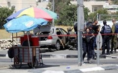 Israeli security forces gather at the scene of a car-ramming attack at the entrance to the West Bank village of Beit Anoun on July 18, 2017. ( Wisam Hashlamoun/Flash90)
