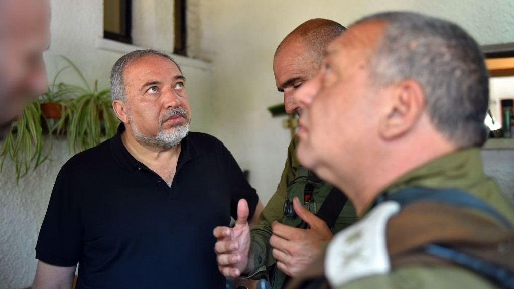 Defense Minister Avigdor Liberman and IDF Chief of Staff Gadi Eisenkot visit the site of a stabbing attack in the West Bank settlement of Halamish on July 22, 2017. (Ariel Hermoni/Defense Ministry/Flash90)