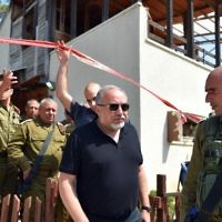 Defense Minister Avigdor Liberman (center) walks before IDF Chief of Staff Gadi Eisenkot (4th left) as they visit the site of a terror attack in the settlement of Halamish, July 22, 2017. (Ariel Hermoni/Ministry of Defense via Flash90)