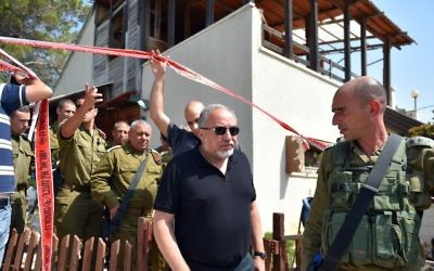 Defense Minister Avigdor Liberman (center) walks before IDF Chief of Staff Gadi Eisenkot (4th left) as they visit the site of a terror attack in the settlement of Halamish, July 22, 2017 (Ariel Hermoni/Ministry of Defense via Flash90)