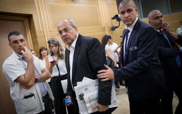 Joint List MK Ahmad Tibi is taken out by security guards during a committee meeting at the Knesset in Jerusalem on July 26, 2017.(Yonatan Sindel/Flash90)