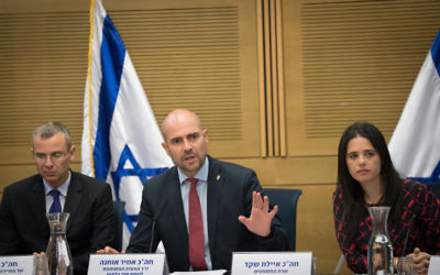 Justice Minister Ayelet Shaked (R), Tourism Minister Yariv Levin (L) and Likud Knesset Member Amir Ohana (C) attend a  committee meeting at the Knesset in Jerusalem on July 26, 2017. (Yonatan Sindel/Flash90)