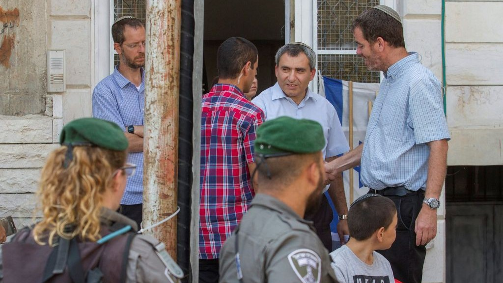 Environmental Protection Minister Ze'ev Elkin (Likud) exits the contested Machpela House in the West Bank city of Hebron on July 27, 2017. (Flash90)