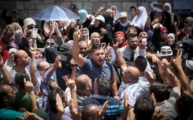 Muslims celebrate in Jerusalem's Old City, following Muslim leaders announcing it is OK to return to pray at the Temple Mount (Hadas Parush/FLASH90)