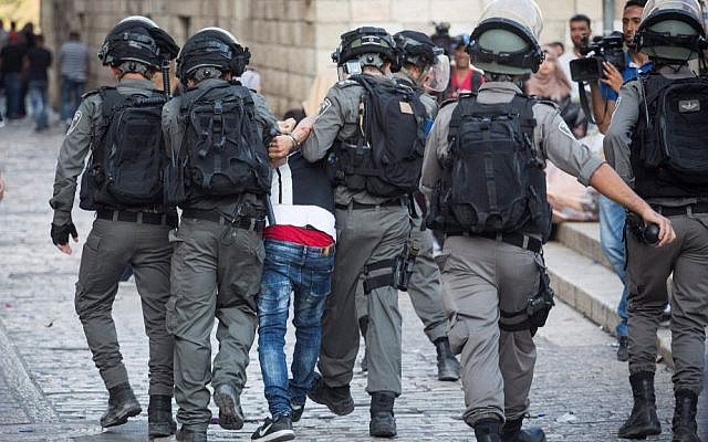 Police arrest a protester during clashes at the Old City of Jerusalem's Lions Gate on July 27, 2017. (Hadas Parush/Flash90)