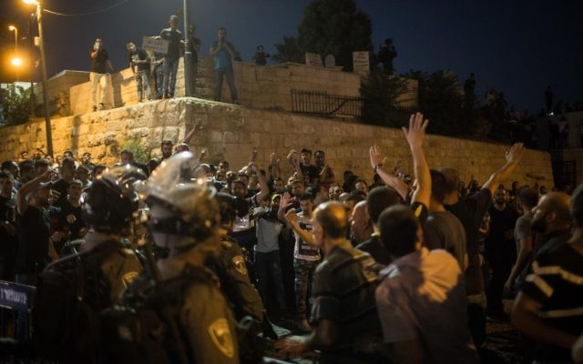 Muslim worshipers protest at at the Lion's Gate in Jerusalem's Old City, after police limited entrance to the Temple Mount to elders and women, July 27, 2017. (Hadas Parush/Flash90)