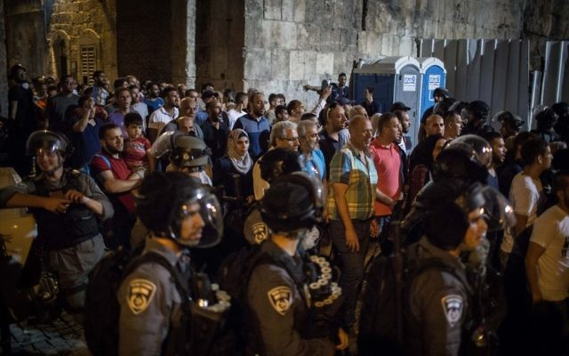 Muslim worshipers and police at the Lions Gate in Jerusalem's Old City on July 27, 2017. (Hadas Parush/Flash90)