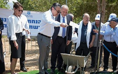 Cheryl Saban (left), Minister of Defense Avigdor Lieberman (center) and former Member of Knesset Shachiv Shanan (center, right) watch as Friends of the Israel Defense Forces National Board Member Haim Saban (center, left) breaks ground at the site of the new FIDF Druze Soldiers Heritage Center, July 2017 (Scally photography).