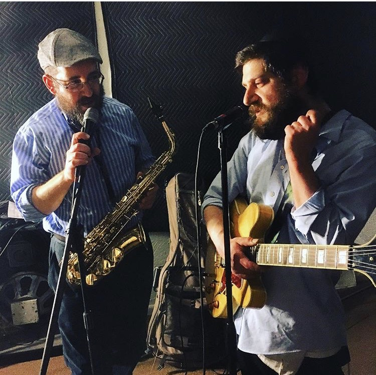 Chillent bandmates Shua Hoexter, left, on saxophone, and Gedaliah Aronson on guitar. (Courtesy Sruli Broocker)
