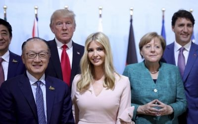 From left: Japanese Prime Minister Shinzo Abe, World Bank Group president, Jim Yong Kim, US president Donald Trump, his daughter Ivanka, German chancellor Angela Merkel and Canada's Prime Minister Justin Trudeau, pose for media at a panel discussion during the G-20 summit in Hamburg, Germany, Saturday, July 8, 2017. (Michael Kappeler/Pool Photo via AP)