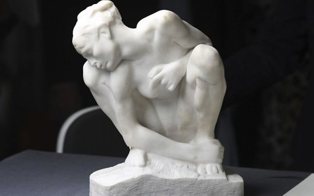 The sculpture 'Kauernde' (lit. 'Cowering') by Auguste Rodin (1840-1917) is on display during a press talk on the preparations of an exhibition of exemplary works from the art collection of Cornelius Gurlitt discovered in 2012, in November in Bonn, Germany, Tuesday June, 27, 2017. (Henning Kaiser/dpa via AP)