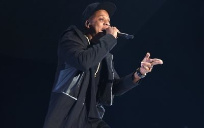 Rapper Jay-Z performs onstage during TIDAL X: 1020 Amplified by HTC at Barclays Center of Brooklyn on October 20, 2015 in New York City. ( Jamie McCarthy/Getty Images for TIDAL via JTA)