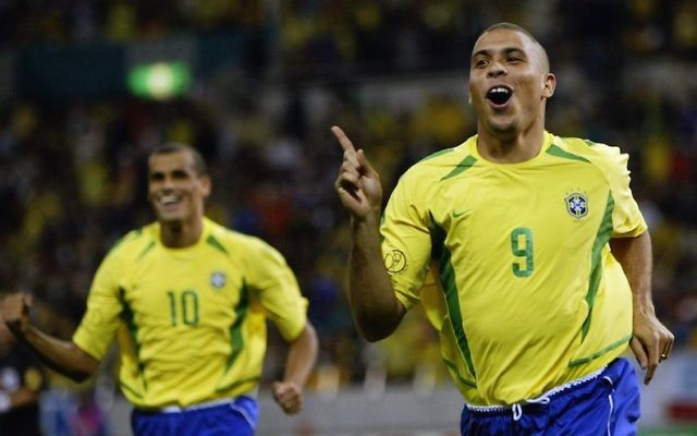 Brazilian soccer legend Ronaldo, right, after scoring a goal in a 2002 World Cup game between Brazil and Turkey played in Japan, June 26, 2002. (Alex Livesey/Getty Images via JTA)