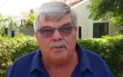 Haim Fogel speaking with reporters outside the Salomon family home in Halamish on July 23, 2017. (Screen capture/Twitter)