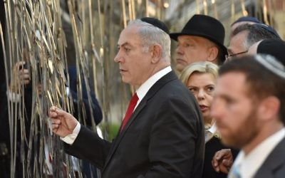Israeli Prime Minister Benjamin Netanyahu, left, in the garden of Dohany Street Synagogue in Budapest, Hungary, Wednesday, July 19, 2017. (Zoltan Mathe/MTI via AP)