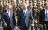 On a four-day official visit in Hungary, Prime Minister Benjamin Netanyahu, right, and his Hungarian counterpart Viktor Orban walk during the reception ceremony in front of the Parliament building in Budapest, Hungary, July 18, 2017. (Balazs Mohai/MTI via AP)