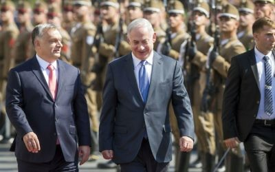 On a four-day official visit in Hungary, Israeli Prime Minister Benjamin Netanyahu, right, and his Hungarian counterpart Viktor Orban walk during the reception ceremony in front of the Parliament building in Budapest, Hungary, Tuesday, July 18, 2017. (Balazs Mohai/MTI via AP)