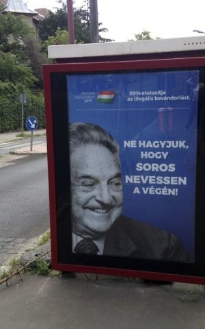 "This photo taken Wednesday, July 5, 2017 in Budapest, Hungary, shows an anti-Soros campaign reading ""99 percent reject illegal migration"" and ""Let's not allow Soros to have the last laugh"". (AP/Pablo Gorondi)"