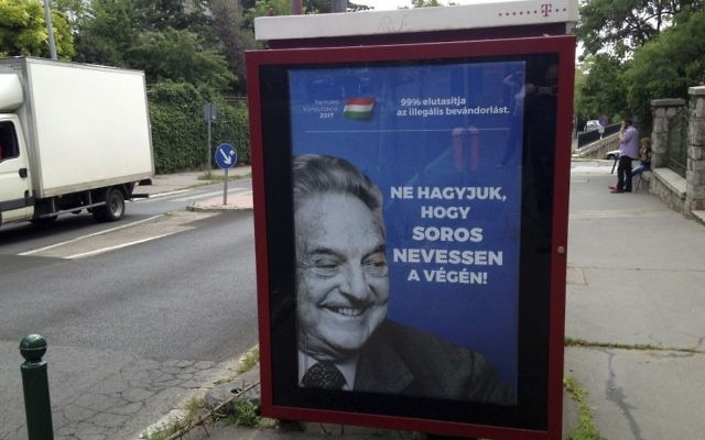 """This photo taken on July 5, 2017 in Budapest, shows an anti-Soros campaign reading """"99 percent reject illegal migration"""" and """"Let's not allow Soros to have the last laugh"""". (AP Photo/Pablo Gorondi)"""