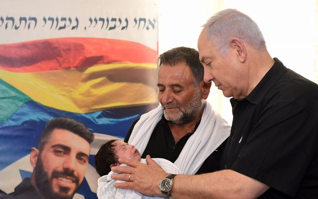 Prime Minister Benjamin Netanyahu visits the Shnaan family, whose son Kamil was killed in a July 14 attack on the Temple Mount, in the northern Druze town of Hurfeish, July 27, 2017. (GPO)