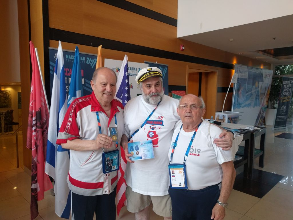 From right to left: Josef Roytman, Vadim Polianski, and Georgian sports announcer Jamlet Khukhashvili. (Yaakov Schwartz/Times of Israel)
