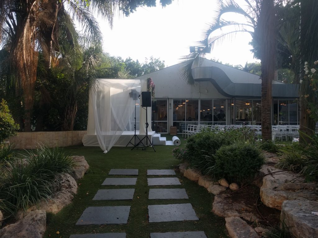 The chuppah in front of the event hall at Kfar Maccabiah. (Yaakov Schwartz/Times of Israel)